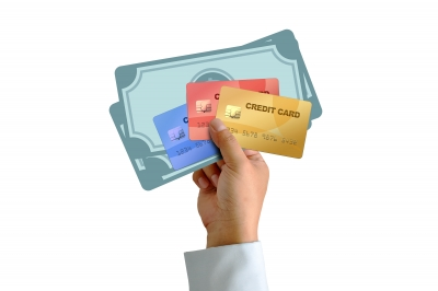 Hand Holding Cash and Credit Cards